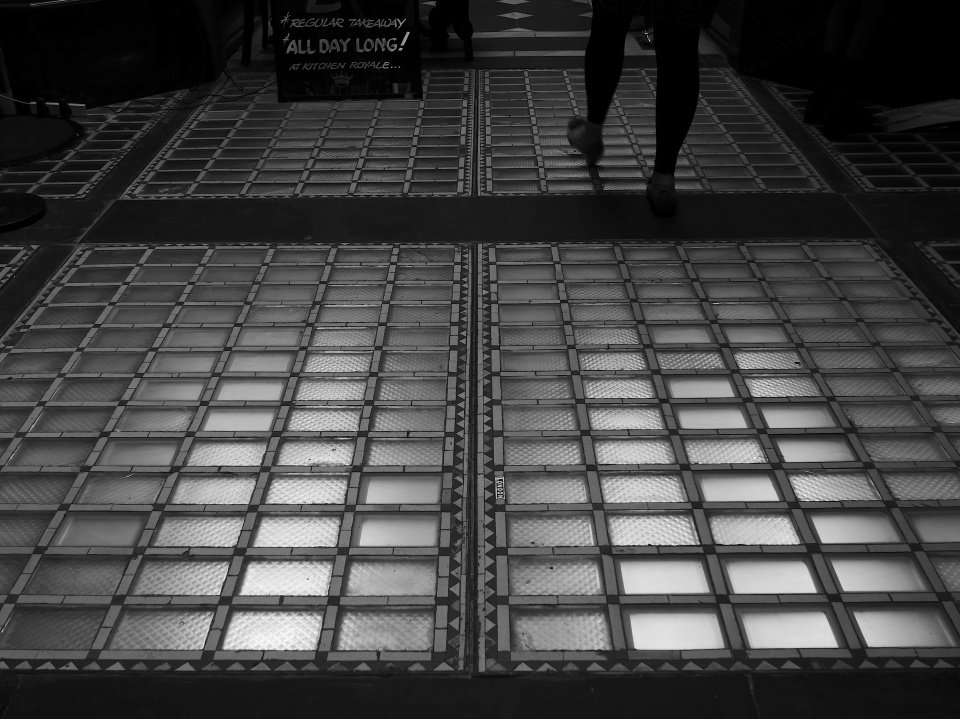 Feet on Glass Tiles